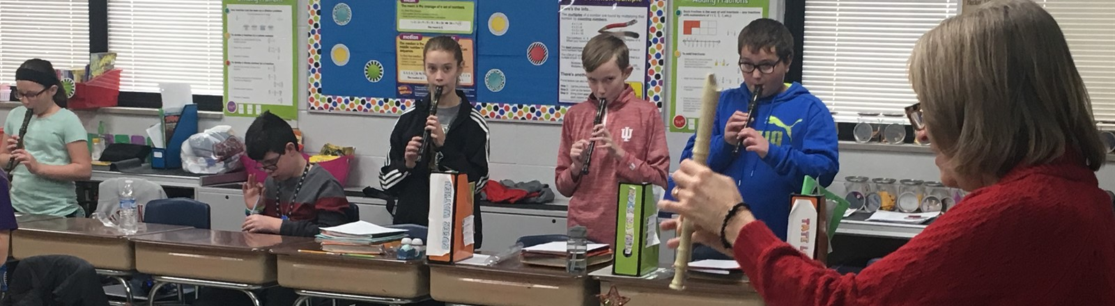 Students playing recorders in music class.